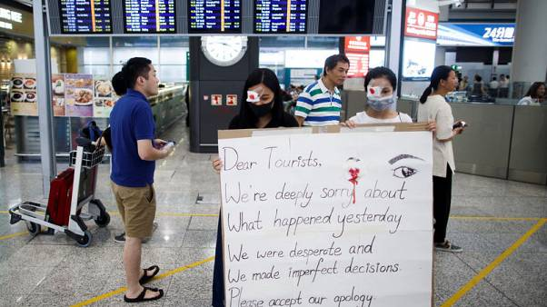 Hong Kong protesters offer apologies, China doubles down after airport clash