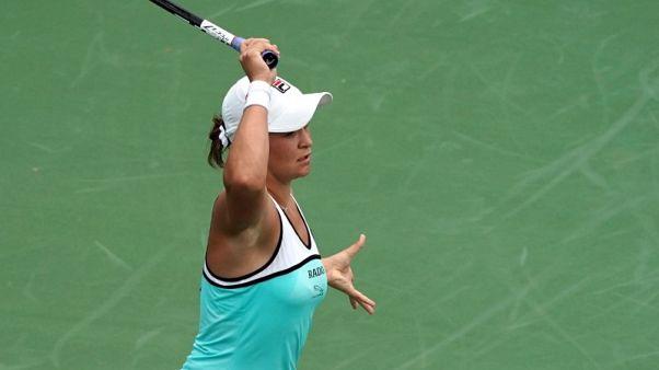Barty outguns Sharapova, Halep survives scare in Cincinnati