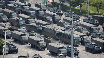 As Hong Kong braces for protests, Chinese paramilitary holds drills across border