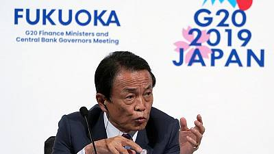 Japan finmin Aso says he hopes markets will calm down