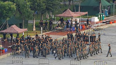 In 'clear warning', Chinese paramilitary forces exercise near Hong Kong