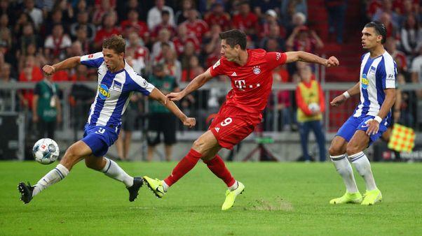Soccer: Lewandowski double rescues draw for Bayern in season opener