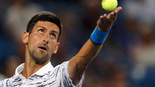 Relentless Djokovic beats Pouille to reach semi-finals