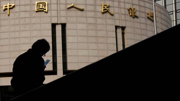 China unveils rate reform to steer funding costs lower for firms