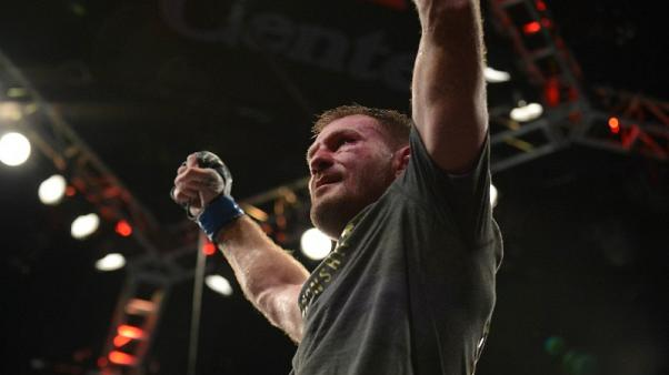 Mixed Martial Arts - Miocic reclaims heavyweight title with knockout win over Cormier
