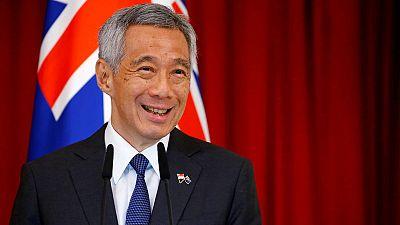 مصحح-100 مليار دولار سنغافوري تنقذ سنغافورة من الغرق