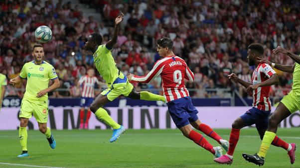 Atletico off to winning start over Getafe as both sides see red