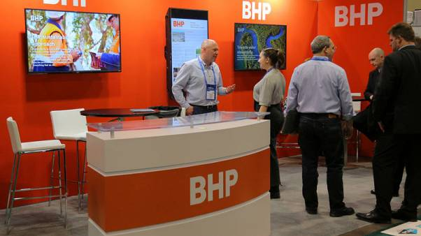 BHP annual profit rises on robust iron ore prices, pays record dividend
