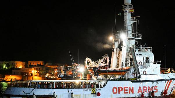 Migrants disembark Open Arms rescue ship on Italian island of Lampedusa