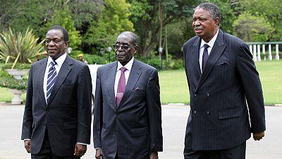 Zimbabwe charges former Mugabe deputy with abuse of office