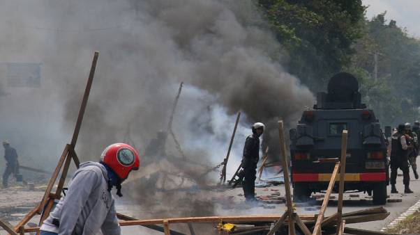 Indonesia blocks internet in Papua to help curb violent protests