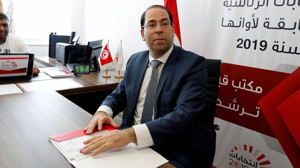 Tunisian PM delegates his powers to focus on presidential race