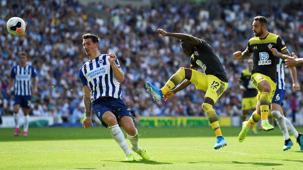 Southampton get off the mark with 2-0 win over 10-man Brighton