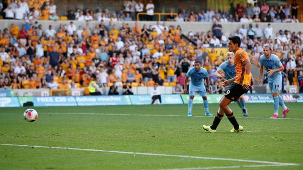 Late Jimenez penalty earns Wolves a point against Burnley