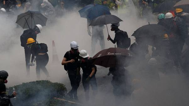Hong Kong police arrest 36, youngest aged 12, after running battles with protesters