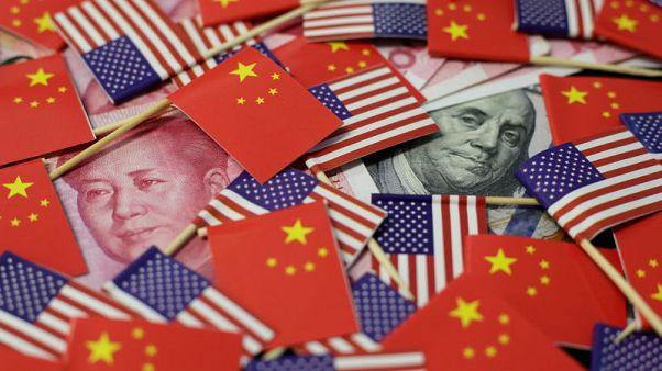 China's yuan slumps to 11-year low, stocks fall as U.S. trade war escalates