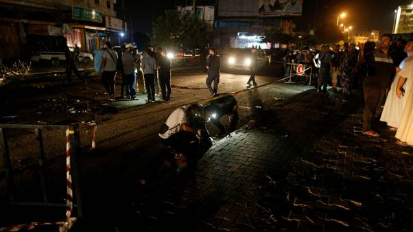 Explosions hit Gaza police checkpoints, two dead -officials