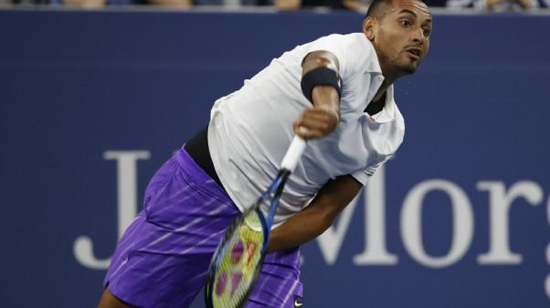 Kyrgios downs Johnson to reach U.S. Open second round