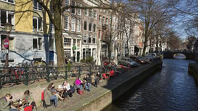 Heady days of Amsterdam's drug culture turn bad as hard stuff  brings violence and corruption
