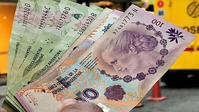Argentine peso falls again, central bank sells $191 million