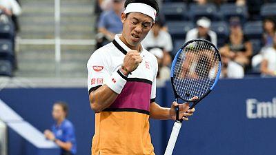 Nishikori fends off spirited Klahn to advance