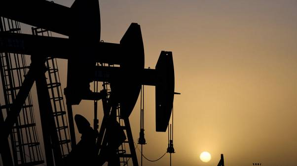 Oil prices hold gains after U.S. inventory drawdown