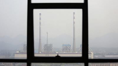 China CO2 emission targets at risk from U.S. trade war - official