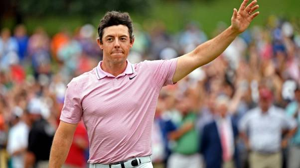 McIlroy closes gap on halfway leader Green at European Masters