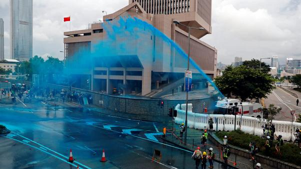 Hong Kong police fire tear gas as march turns into violent chaos