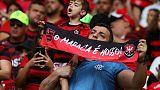 Soccer - Brazilian fans ignore foul play as crowds soar