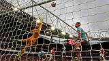 Aubameyang earns 3-2 win for 10-man Arsenal over Villa