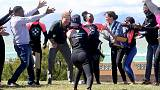 Harry and Meghan dance with mental health mentors on Cape Town beach