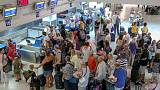 As Thomas Cook customers return home, blame game begins