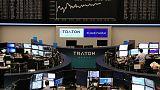 European shares edge higher on trade hopes, Imperial Brands slides