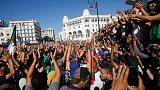 Algerians tired of ruling cadre march as ex-premiers bid for presidency