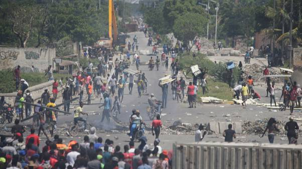 Haitian police use tear gas, live ammunition to break protests