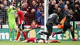 Liverpool march on, Man City keep up chase