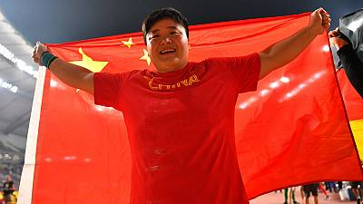 China's Gong retains shot put title by eight cm