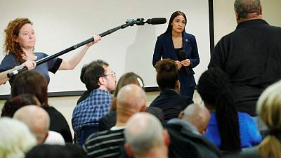 Ocasio-Cortez sells ambitious U.S. welfare legislation in home district