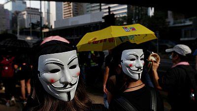 Hundreds return to Hong Kong streets as metro, shops shut after violence
