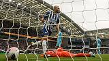 Seagulls soar as two-goal Connolly humbles Spurs
