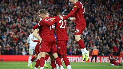 Last-gasp Milner keeps Liverpool flying; Spurs crash again