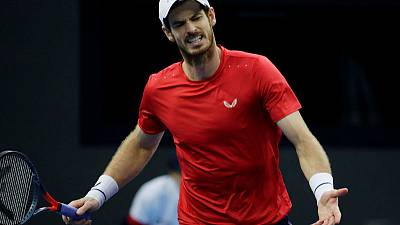 Murray wobbles but roars back to win Shanghai opener