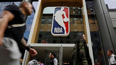 China TV drops NBA exhibition games, escalating pressure amid tweet uproar