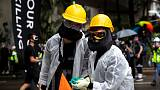 Police say 77 people arrested in Hong Kong for anti-mask law violations