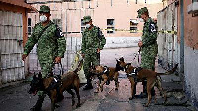 Police, dogs search notorious Mexican prison for clandestine graves