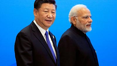 India's Modi to host China's Xi at summit with ties strained by Kashmir