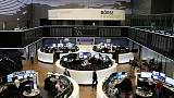 Upbeat earnings boost European shares; trade caution prevails