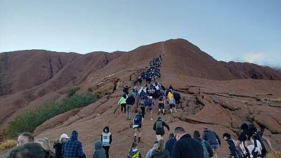 Thousands rush to climb Australia's Uluru ahead of ban