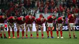 Brilliant Adams grabs hat-trick as battered Wales reach quarters